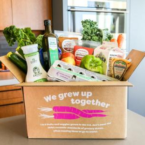Imperfect Foods box of produce on kitchen counter