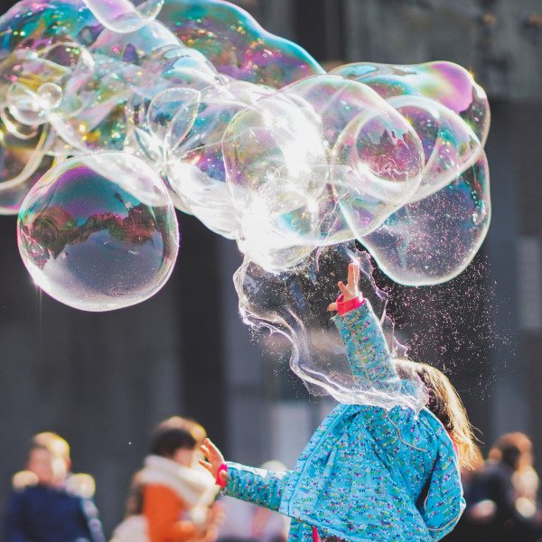 Child popping bubbles